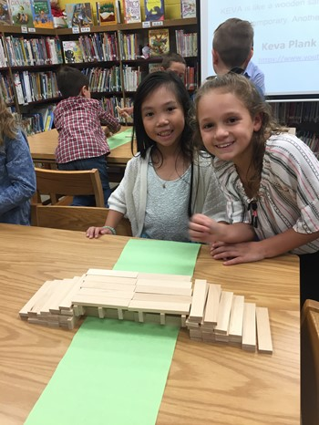 Two students with their bridge