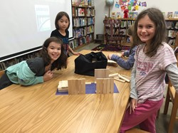 Three students with their bridge