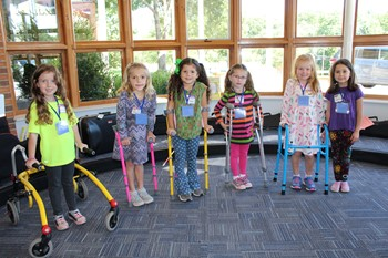 Six students with crutches or walkers