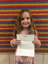 Ava with the letter telling her she won the contest