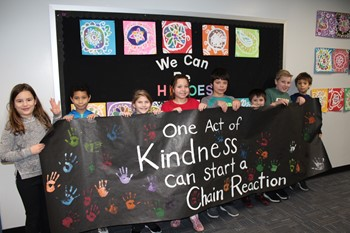 Eight students holding the Rachel's Challenge Banner