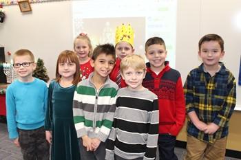 Eight Memorial Students who gave the Holiday Traditions presentations