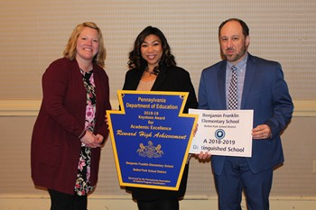 Franklin Principal Teresa Doumont and two representatives from the Pennsylvania Department of Education