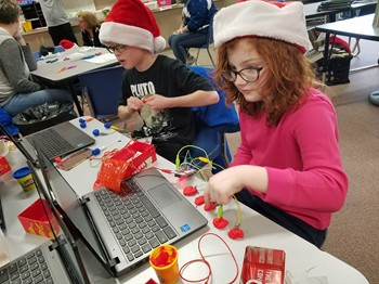 Two students participating in a Makey activity