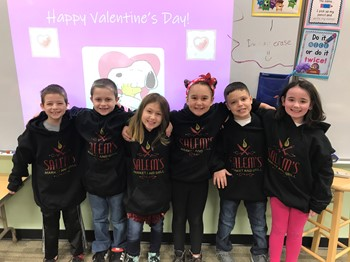 Six students wishing everyone a Happy Valentine's Day