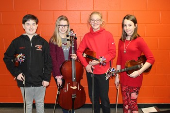 The four NAMS Elementary String Fest Musicians