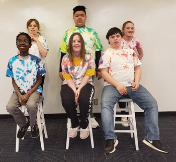 Six students with their tie dye t-shirts
