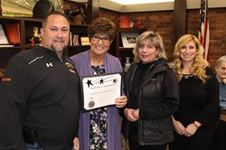 Three members of the BP Baseball Boosters Board and School Board President Donna Cook