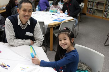 Student and parent with an iPad