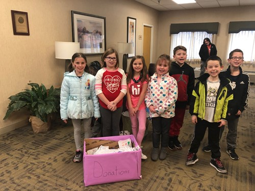Students with their collected items at the nursing home