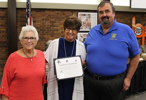 Mrs. Cook thanks two members from the Rotary Club