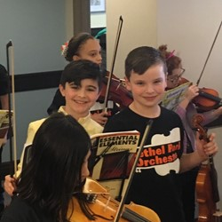 Two students getting ready to play