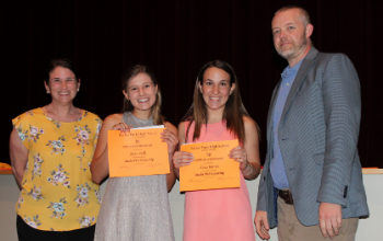 Two students receive a scholarship