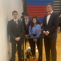 Four students at the catapult competition