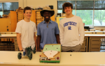 Three students with their projects