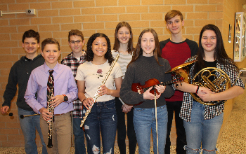 The eight BPHS Junior High District Orchestra musicians