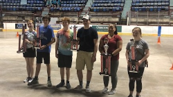 Six students holding trophies