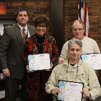 Dr. Pasquerilla and the three honored Board Members
