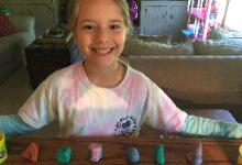 student with her six 3D clay models