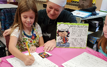 Mrs. Crowley working with a student
