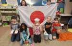 Students holding the Japanese flag