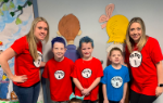 Three students and two teachers dressed as Thing 1 and Thing 2