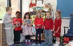 Six students reciting a poem