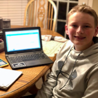 student with ALEKS on his computer