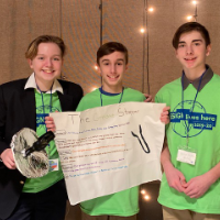 The three students with their invention