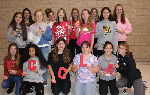 Students holding their positivity rocks
