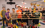 The Inventors Club students holding planes and wings