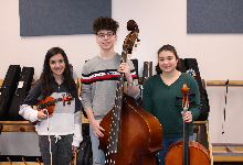 The three Junior High District Orchestra musicians