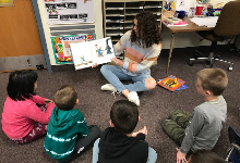 BPHS student reading to Lincoln students