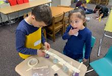 Two students building a bridge