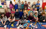 Kindergarten students with a pile of socks