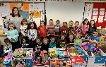 Kindergarten students with the toys they collected