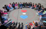 Students sitting in a circle wearing crazy socks