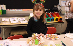 Student with her gingerbread house