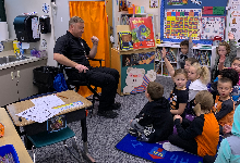 Sgt. Collins speaking to the first graders
