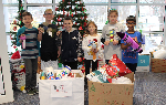 Six students with some of the collected pet supplies