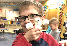 Student with his marshmallow snowman