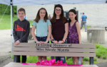 The four students who participated in the bench dedication ceremony