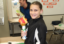 Student holding an Olympic torch