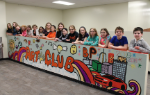 5th graders and their mural