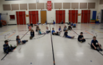 Students forming a ribbon on the floor