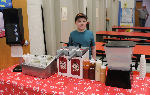D.J. behind the condiment table