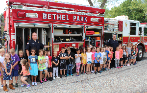 Students gathered in front of the fire truck