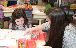 BPHS student helping a Penn student