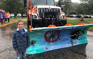 Student with his winning snow plow design