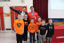 Six students with the two assembly presenters
